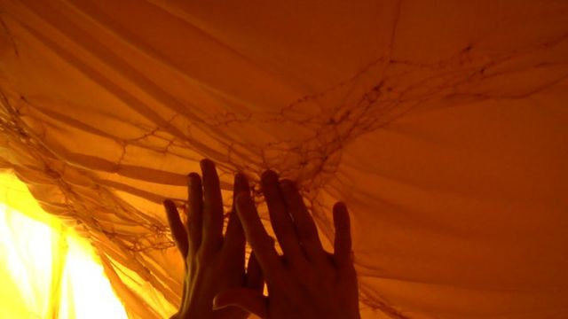 image: video still from installation and performance. Performer and creator: Jes Gamble, 2010